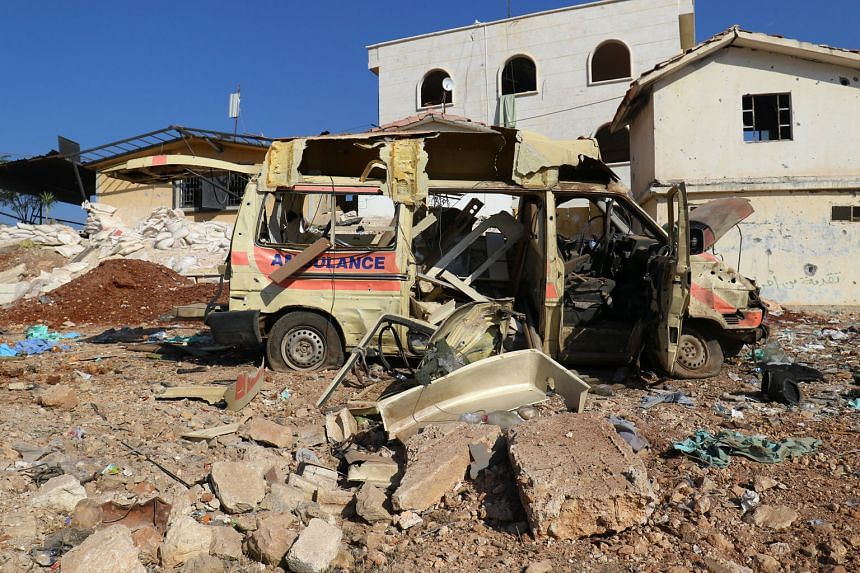 What's left of an ambulance after an air strike on the rebel-held town of Atareb, in the countryside west of Aleppo, Syria, yesterday. A hospital in the town was hit five times on Monday. The strikes destroyed operating rooms and the pharmacy, damaged amb