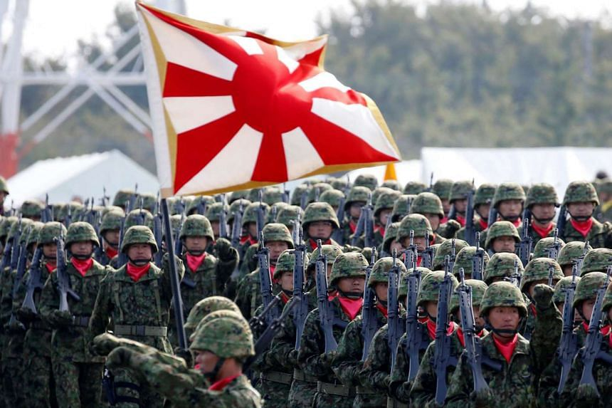 Under new laws, it will be the duty of Japan's Self-Defence Forces (left) to rescue United Nations staff and employees of non-profit groups working in peacekeeping operations in conflict-torn South Sudan if they were to come under siege.
