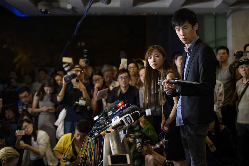 Ms Yau Wai Ching and Mr Sixtus Leung speak to the media outside the High Court in Hong Kong after the judgment of a judicial review was handed down yesterday. They say they will appeal against the judgment and apply to stop it from being carried out.