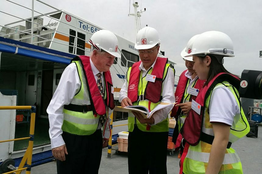 Professor Kees d'Angremond (left) and HDB officers discuss the reclamation.