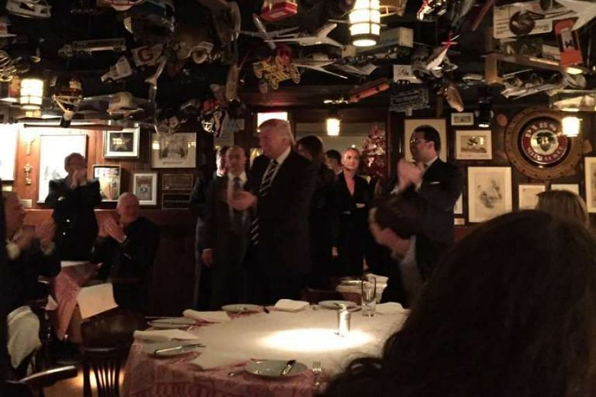 Donald Trump received a standing ovation at the 21 Club restaurant.