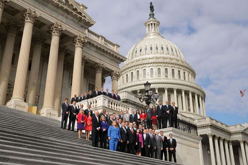 Incoming Republican and Democratic members of Congress pose for a group photograph on the steps of the House of Representatives on Nov 15, 2016.