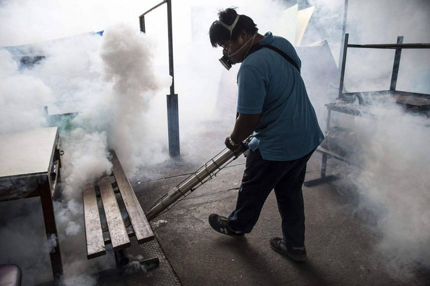 A city worker sprays chemicals with a fumigator to kill mosquitoes in an effort to control the spread of the Zika virus at a school in Bangkok on Sept 14, 2016.