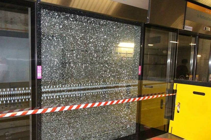 """The severely-cracked glass panel was damaged due to a """"material defect"""" in the glass, rail operator SMRT Corp said on Thursday (Nov 17)."""