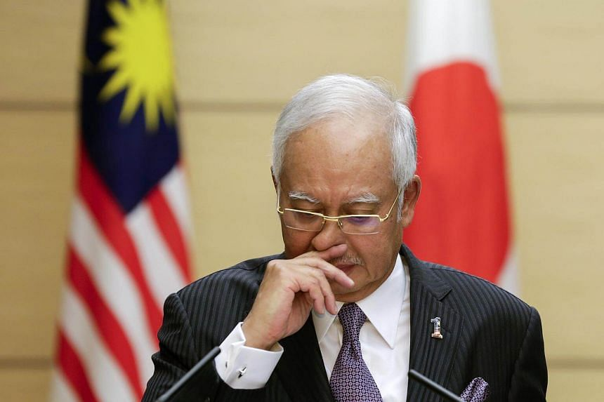 Malaysian Prime Minister Najib Razak takes a moment as he speaks during a joint press conference with Japanese Prime Minister Shinzo Abe.