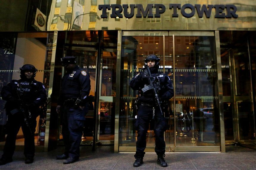 US secret service agents stand guard outside President-elect Donald Trump's Trump Tower in New York on Nov 12, 2016.