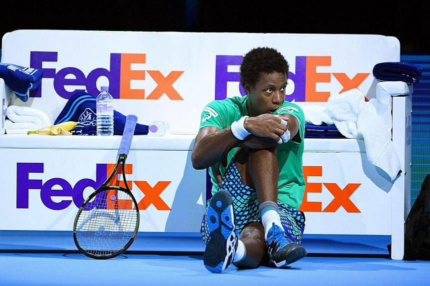 Gael Monfils of France reacts during a break of his men's singles match against Dominic Thiem of Austria at the ATP World Tour Finals tennis tournament.