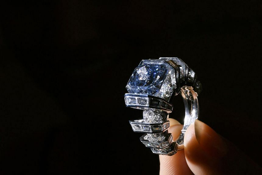 The Sky Blue Diamond, a fancy vivid blue diamond ring created by Cartier, during a press preview by Sotheby's Auction House in Geneva.
