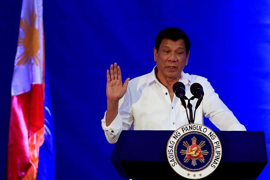 Philippine President Rodrigo Duterte gestures while delivering a speech during the 80th National Bureau of Investigation (NBI) founding anniversary.