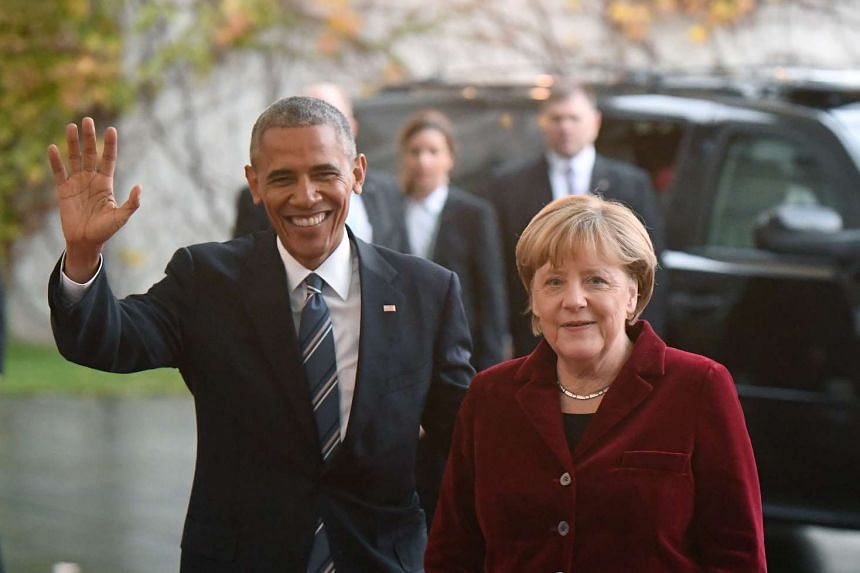 US President Barack Obama is greeted by German Chancellor Angela Merkel outside the Federal Chancellery in Berlin on Nov 17, 2016.