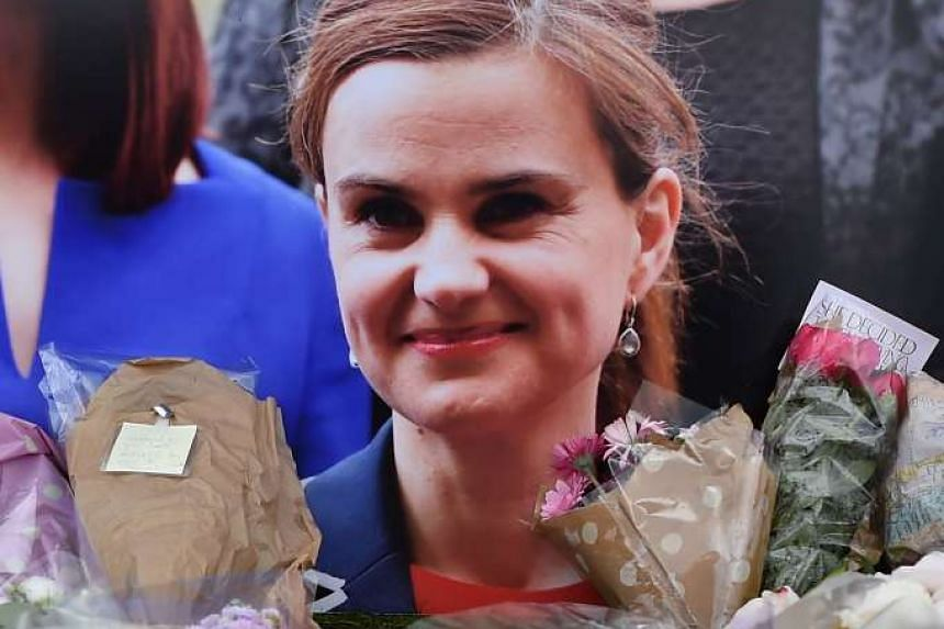 Flowers and tributes are piled in remembrance against a photograph of slain Labour MP Jo Cox in a June 2016 file photo.