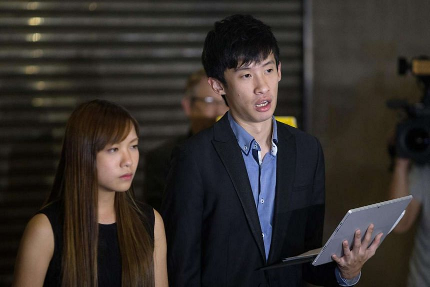 Ms Yau Wai-ching and Mr Sixtus Leung Chung-hang speak to reporters outside the High Court after the handing down judgement of a judicial review in Hong Kong.