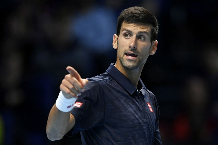 Serbia's Novak Djokovic in action during his round robin match with Canada's Milos Raonic.