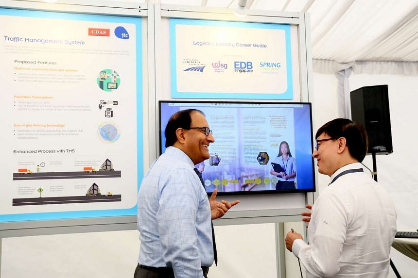 Minister S Iswaran viewing the exhibit showcase for the Logistics Industry Career Guide.