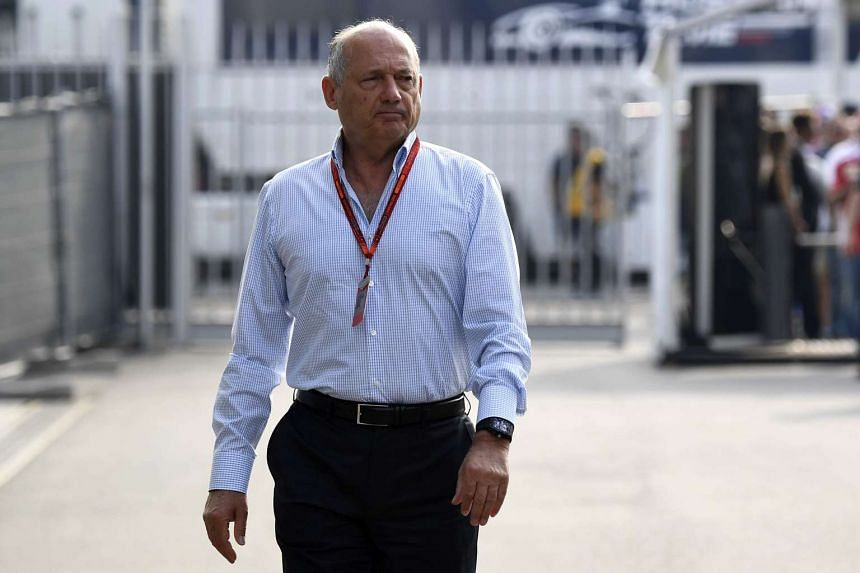 Ron Dennis walking before the third practice session at the Autodromo Nazionale circuit in Monza.