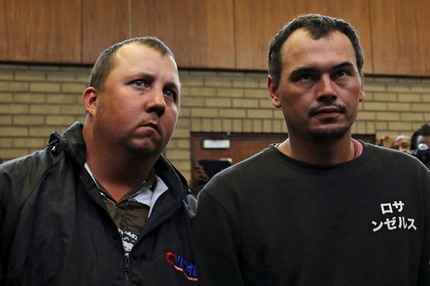 Theo Martins and Willem Oosthuizen (right) appear at the Middelburg magistrates High Court, in Mpumalanga province, South Africa on Nov 16, 2016.