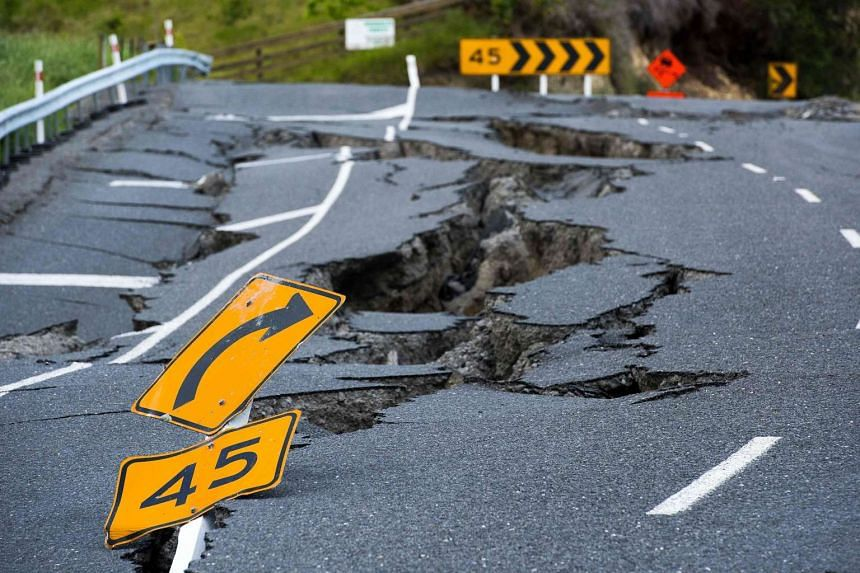 Earthquake damage to State Highway 1 is seen south of Kaikoura on Nov 16, 2016.