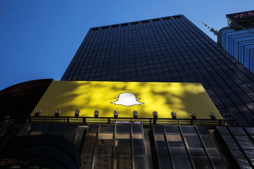 A billboard displays the logo of Snapchat above Times Square in New York.
