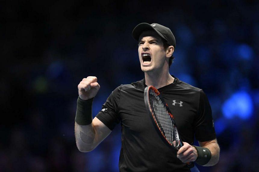 Andy Murray celebrates during his round robin match against Japan's Kei Nishikori.