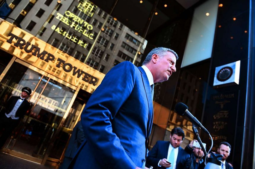 Bill de Blasio talks to the press in front of Trump Tower after meetings with Donald Trump.