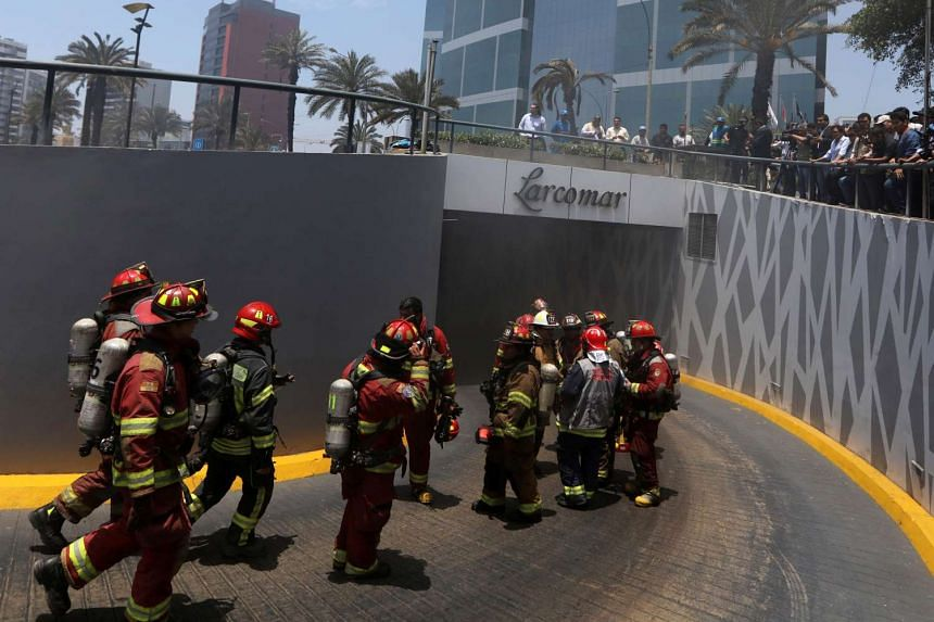 Firemen work on the blaze at Larcomar mall in Lima, Nov 16, 2016.