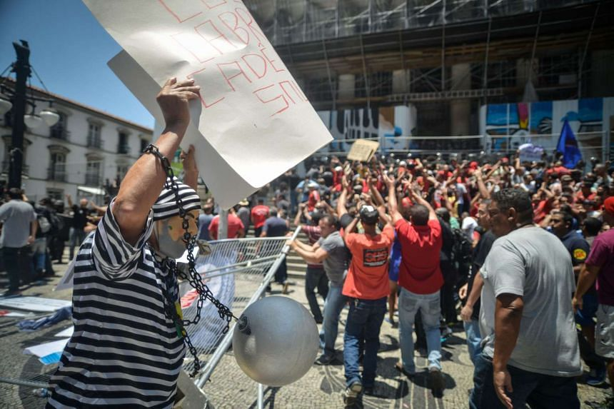 Demonstrators clash with riot police during a protest by Rio de Janeiro state's public servants against austerity measures.