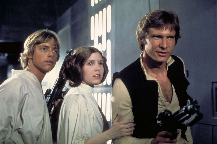 Star Wars actors (from left) Mark Hamill as Luke Skywalker, Carrie Fisher and Harrison Ford in a still from Star Wars: A New Hope.