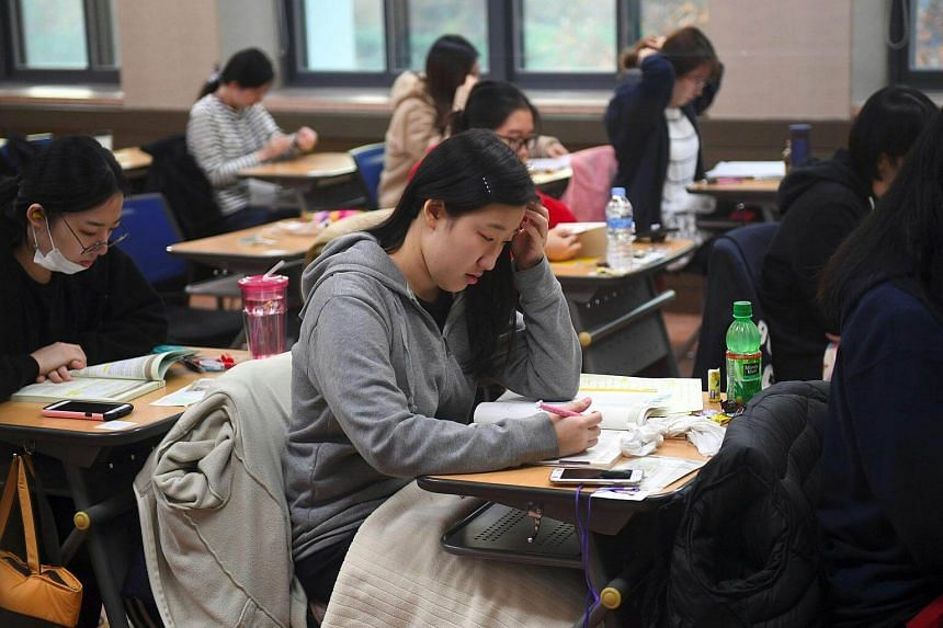 Students sit the annual College Scholastic Ability Test, a standardised exam for college entrance, at a high school in Seoul.