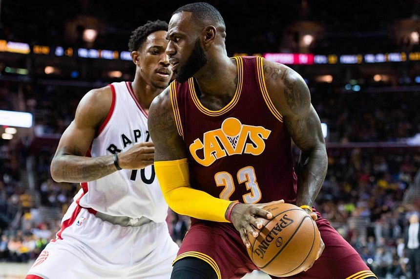 LeBron James #23 of the Cleveland Cavaliers fights for position with DeMar DeRozan #10 of the Toronto Raptors.