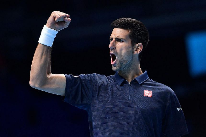Serbia's Novak Djokovic reacts after taking a 6-5 lead in a first set tie-break against Canada's Milos Raonic.