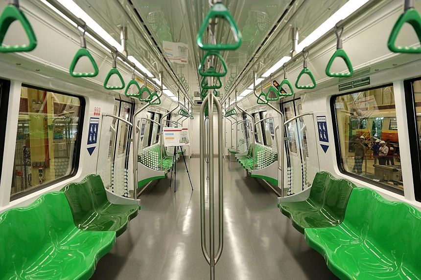 Top: The 19 six-car trains will have new cabin lighting and doors. Below: There will also be a new, graphical route map information system on board.