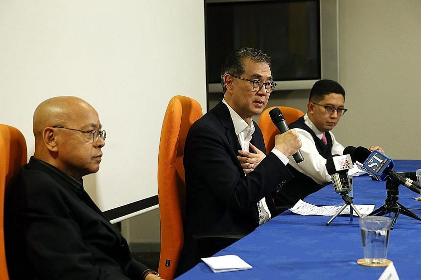 Mr Kwok was dismissed after a disciplinary hearing. NKF chairman Mr Koh, flanked by board members, Dr Wan (left) and Associate Professor Abdul Razakjr Omar, speaking at a media conference yesterday.