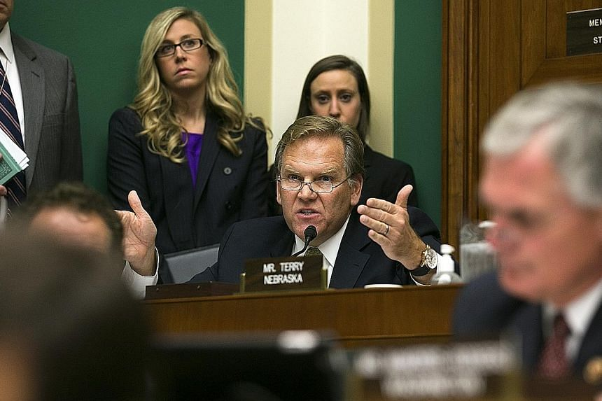 Former congressman Mike Rogers (above) and lobbyist Matthew Freedman (left) have been removed from the Trump transition team. The pair had been handling national security for the team.