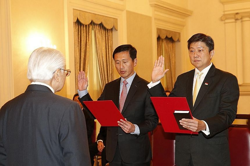 President Tan officiating at the swearing-in and appointment ceremony of Education Ministers Ng Chee Meng (far right) and Ong Ye Kung at the Istana yesterday.