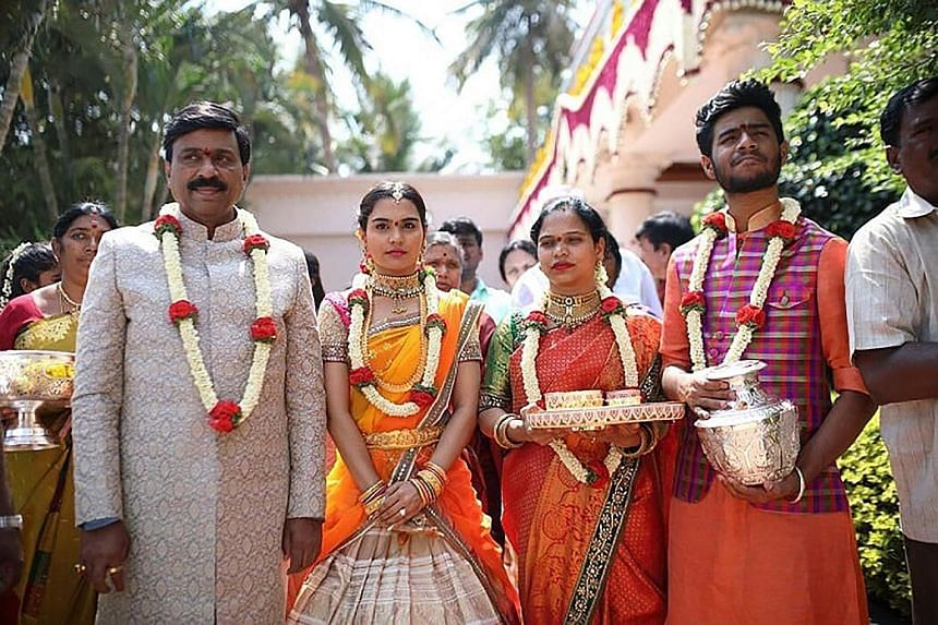Mr Reddy (left) with his daughter and other family members at the wedding. A total of 50,000 people were expected to have turned up for the five-day extravaganza at the Bangalore Palace, a mock Tudor castle in southern India, for the wedding. Mr Redd