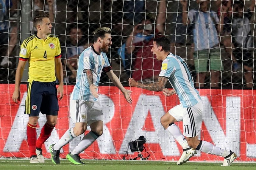 Lionel Messi (centre) and team-mate Angel di Maria celebrating a goal during the 3-0 win against Colombia in the World Cup qualifying match in San Juan, Argentina on Tuesday. Messi scored one goal and assisted in the other two as his side bounced bac