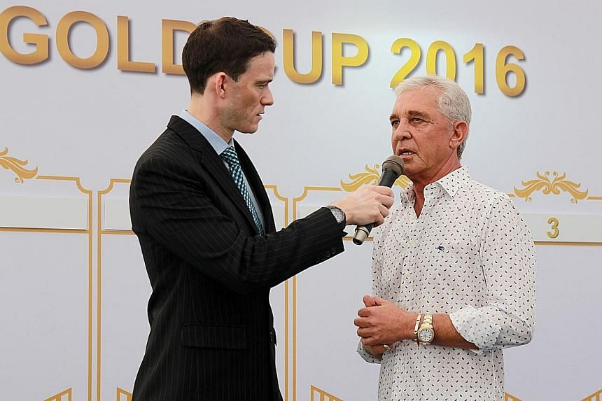 South African trainer Patrick Shaw (right) at the barrier draw of the Dester Singapore Gold Cup yesterday. The 60-year-old has four contenders in the field of 12, more than any other trainer, and is looking to win his third consecutive Singapore Gold