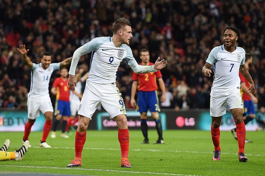 It's party time for Jamie Vardy, Raheem Sterling and Theo Walcott (No. 14), as the Leicester striker celebrates by doing the mannequin challenge after heading past Spanish goalkeeper Jose Reina to put England 2-0 up. But two late goals let the visito