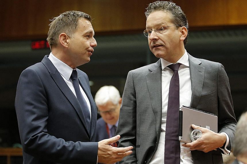 Mr Dijsselbloem (right), with Slovak Finance Minister Peter Kazimir, says Dutch law would not allow for a referendum in the Netherlands on EU membership.