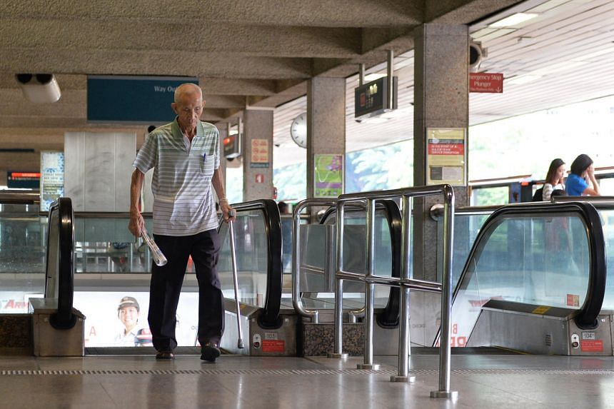 A man taking the escalator at Ang Mo Kio MRT station yesterday morning. The 17 elderly commuters TNP spoke to said that they experienced no difficulties coping with the speeds of the escalator that was going up towards the platform.