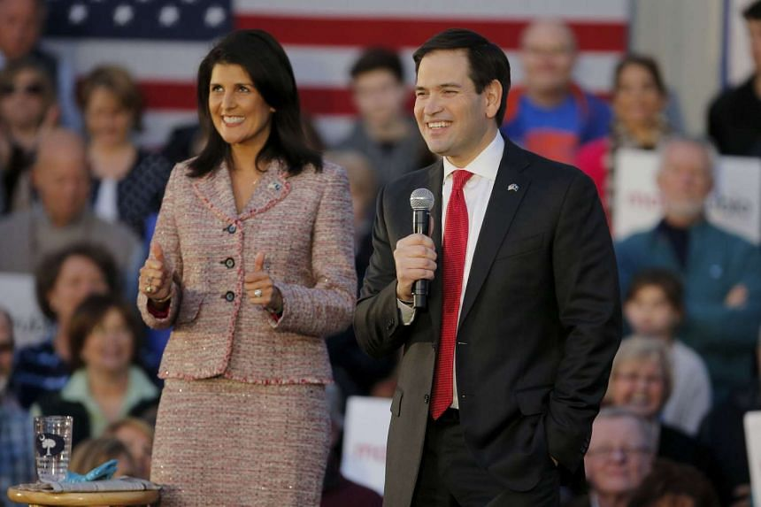 South Carolina Governor Nikki Haley (left) gives a thumbs up during a campaign event in Chapin as US Republican presidential candidate Marco Rubio speaks on Feb 17, 2016.