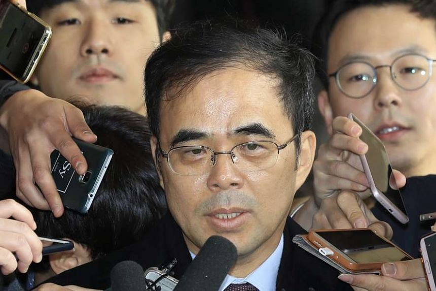 Former vice sports minister Kim Chong responds to reporters' questions after arriving at the Seoul Central District Prosecutors' Office in Seoul on Nov 16, 2016.