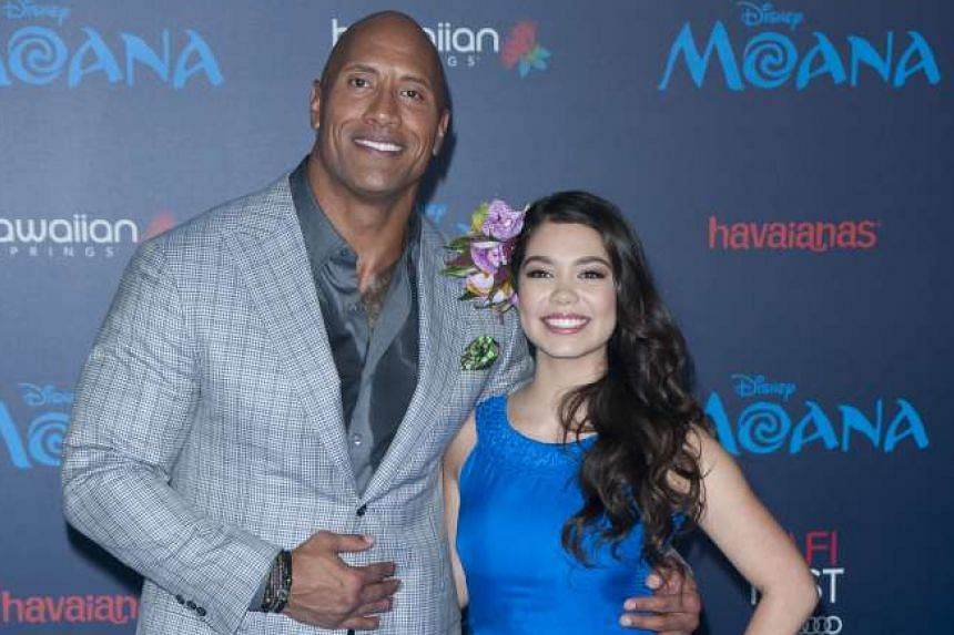 Dwayne Johnson, who is the voice of demigod Maui, and Auli'i Cravalho, the voice of Moana, at the premiere of the Disney film on Monday.
