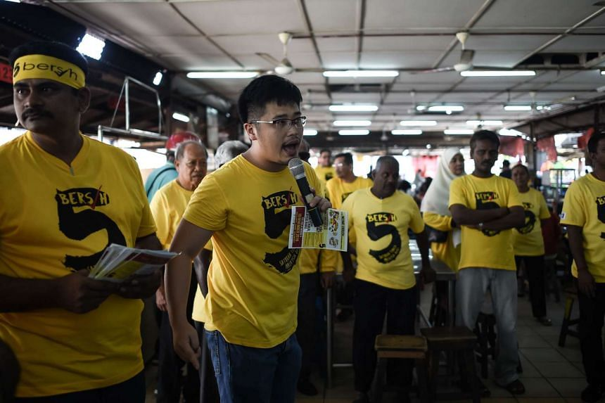 A member of Bersih delivering a speech at a wet market ahead their demonstration in the capital Kuala Lumpur to demand Najib's resignation in Ipoh on Nov 11, 2016.
