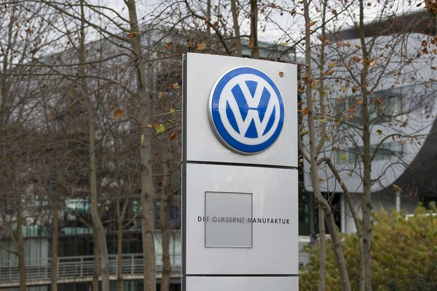 The Volkswagen AG (VW) logo sits on a sign outside the VW factory in Dresden, Germany, on Nov 17, 2016.