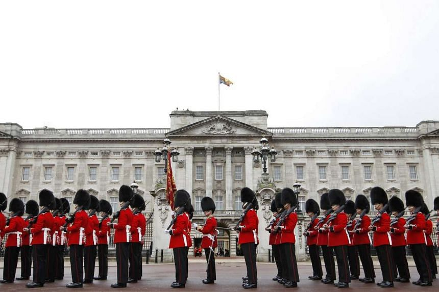 Irish Guards leave Buckingham Palace after forming the honour guard for Britain's Queen Elizabeth during the State Opening of Parliament in London on May 9, 2012.