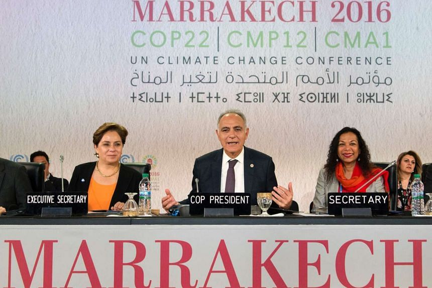 COP22 president Salaheddine Mezouar (center), executive secretary Patricia Espinosa (left), and secretary attend a press conference at the COP22 climate conference on Nov 17, 2016, in Marrakesh.