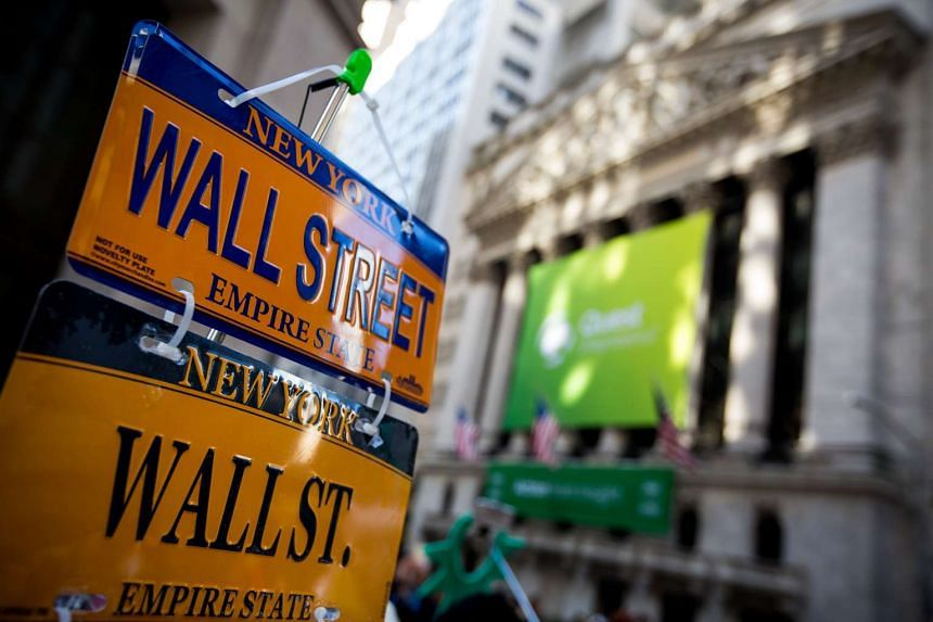 Wall Street license plate souvenirs are displayed in front of the New York Stock Exchange in New York on Nov 14, 2016.