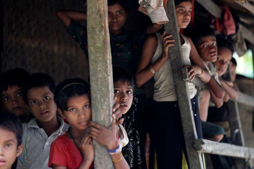 Rohingya Muslim children stand in U Shey Kya village outside Maungdaw in Rakhine state on Oct 27, 2016.