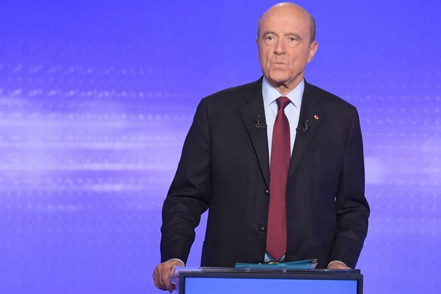 Candidate for the right-wing party primaries ahead of the 2017 presidential election former Prime minister and Bordeaux's mayor Alain Juppe prepares to take part in a televised debate in Paris on Nov 17, 2016.